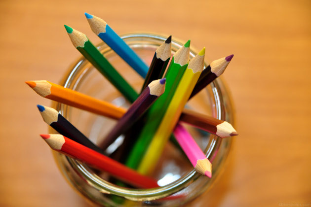 a glass with coloring pens